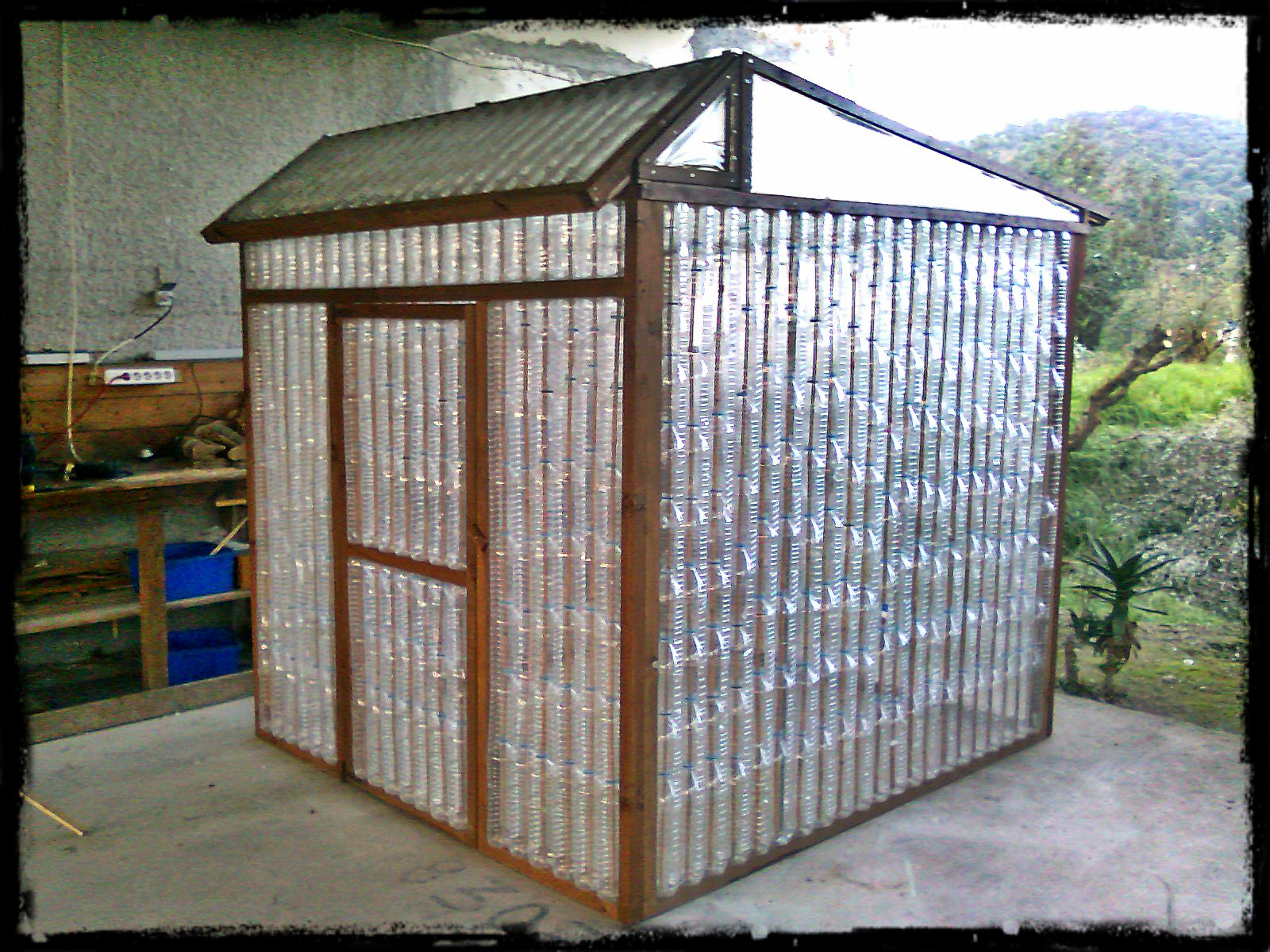 Greenhouse from recycled plastic bottles our hither green for What is a greenhouse made out of