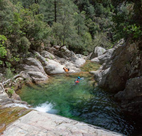 People enjoying cannoying in Purcaraccia canyon in Corsica, France.