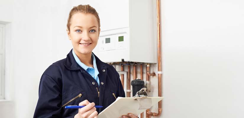plumber performing boiler service