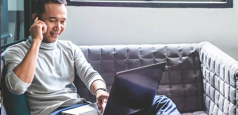 man choosing insurance on laptop