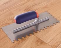 Flooring adhesive trowel