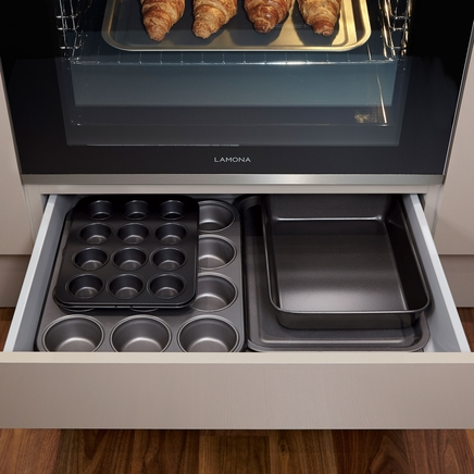 built under oven housing with shallow storage drawer