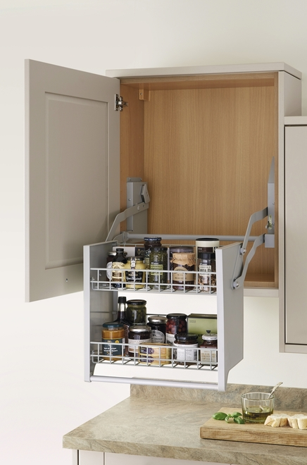 A pull-down shelf allows easy access to wall units.