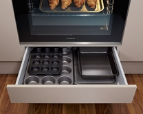 Built-under oven housing with shallow storage drawer