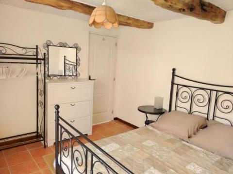 La Petite Longere, double bedroom with french door to the terrace