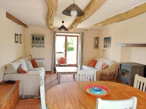 La Petite Longere, living room with french doors to the terrace