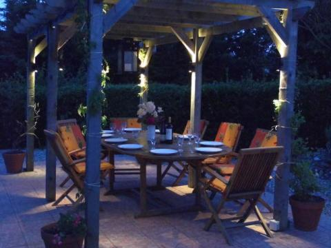 The Pergola, gently lit for evening dining
