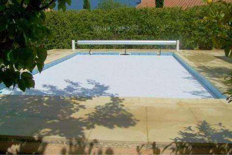Electrically operated pool security cover closed
