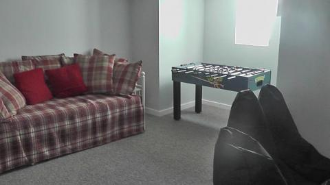games room with football table & xbox. can be used as lower ground floor bedroom