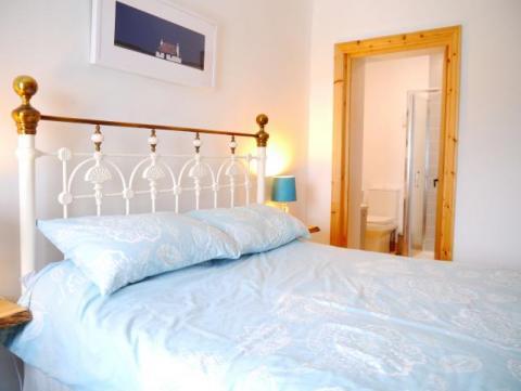 King size bedroom with en suite