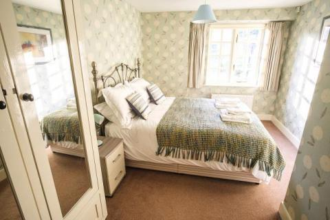 King size bedroom on lower ground floor, adjacent shower room & separate loo