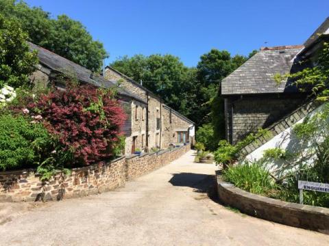 Entrance to the courtyard with the Corn Barn on the left.  East Trenean Farm - luxury holiday cottages in Cornwall