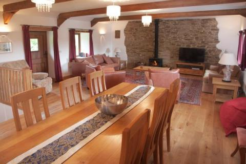 The dining area and lounge in the Corn Barn The Corn Barn at East Trenean Farm, luxury holiday cottage, Cornwall