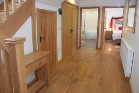 The lower floor in The Corn Barn at East Trenean Farm, luxury holiday cottage, Cornwall