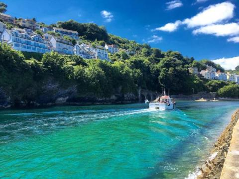 Take a boat trip in near-by Looe while staying at East Trenean Farm, Cornwall