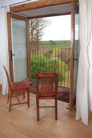 Enjoy the view from the living area in the Threshing Barn