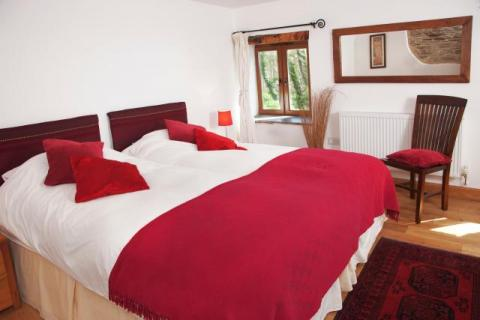 Bedroom 2 in the Water Mill at East Trenean Farm luxury holiday cottage near Looe, Cornwall
