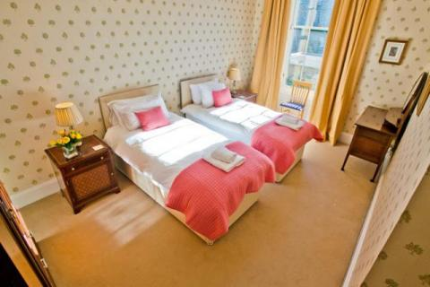 spacious bedroom two single beds