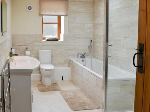 family bathroom with separate bath & shower