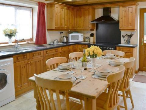 well equipped farmhouse kitchen with electric range, dishwasher etc