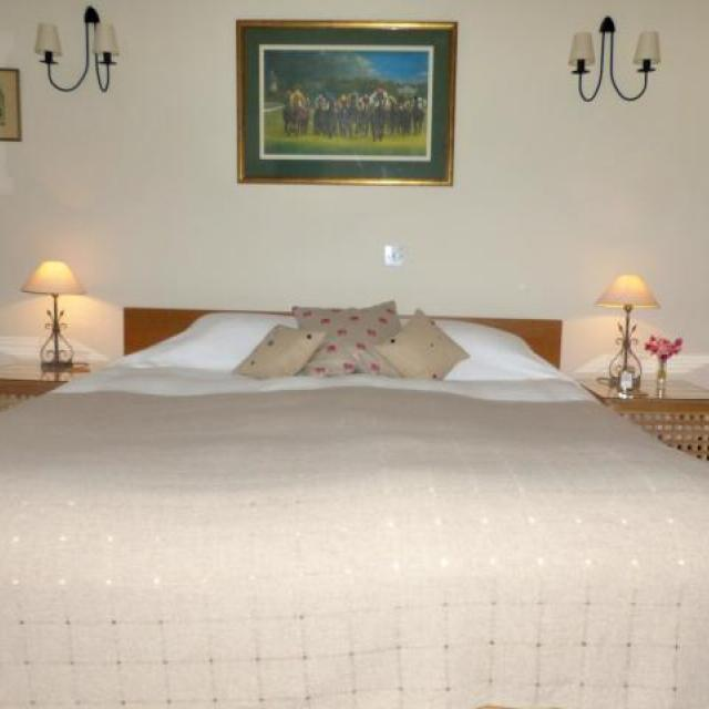 King bed made up with separate mattresses and bedding (Austrian twins)