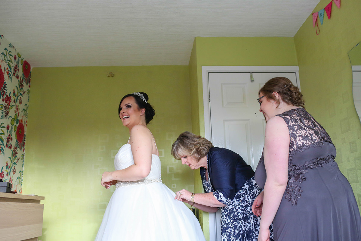 Bride getting ready. Manchester and Cheshire Wedding Photographer, Cottons Hotel Wedding Photography