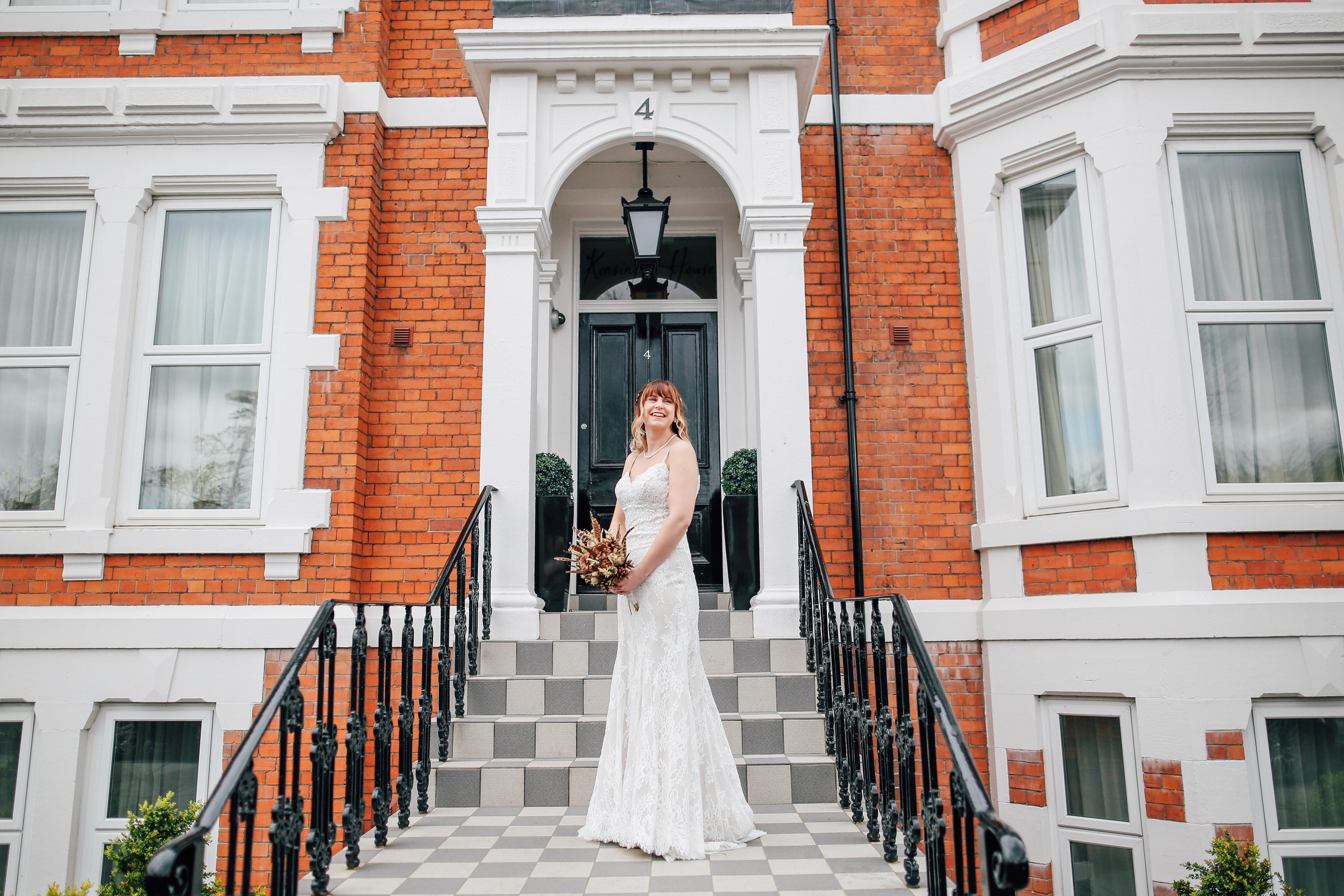 Bride in front of house Manchester Wedding Photography