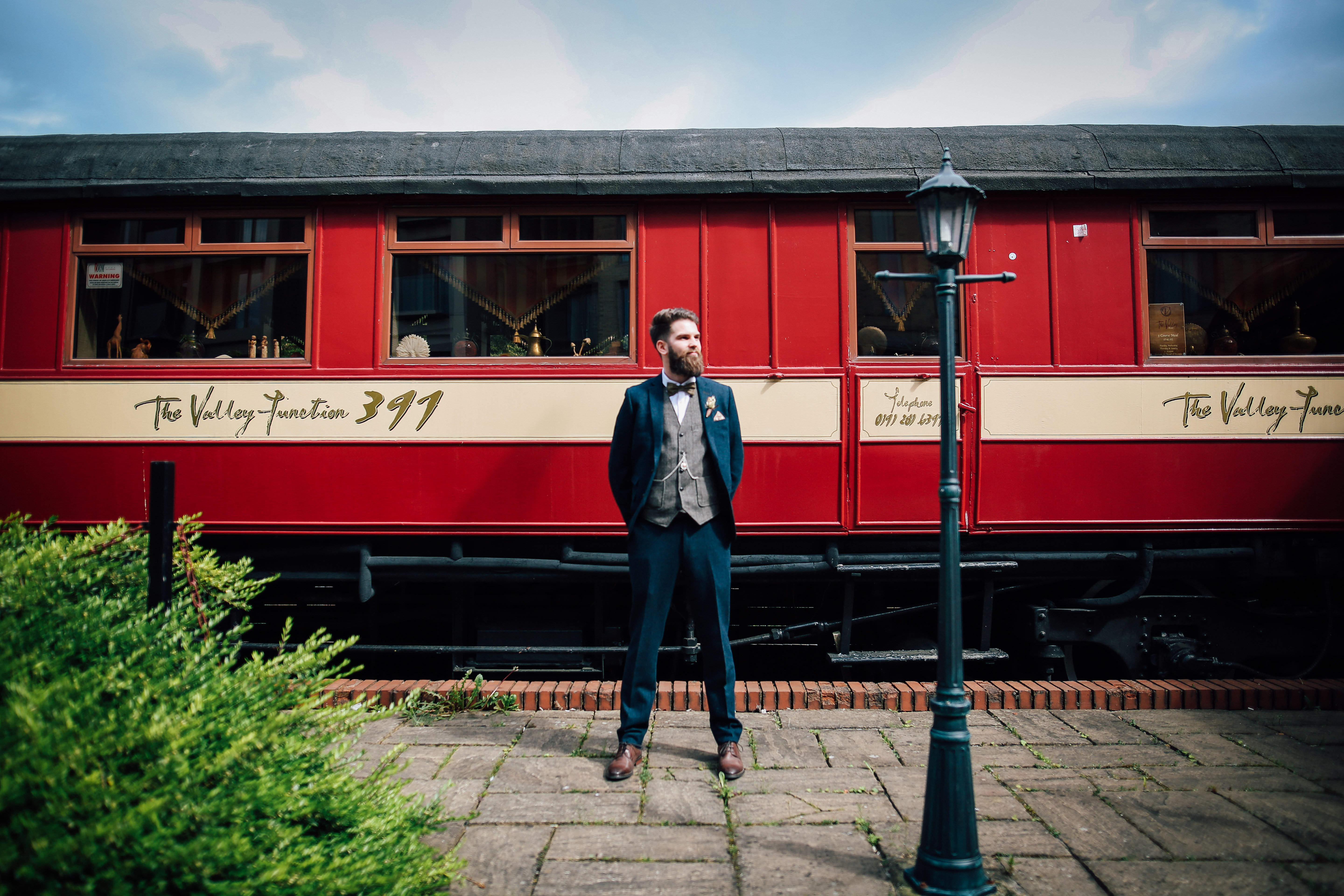 Groom in front of train Newcastle Wedding Photography As You Like It