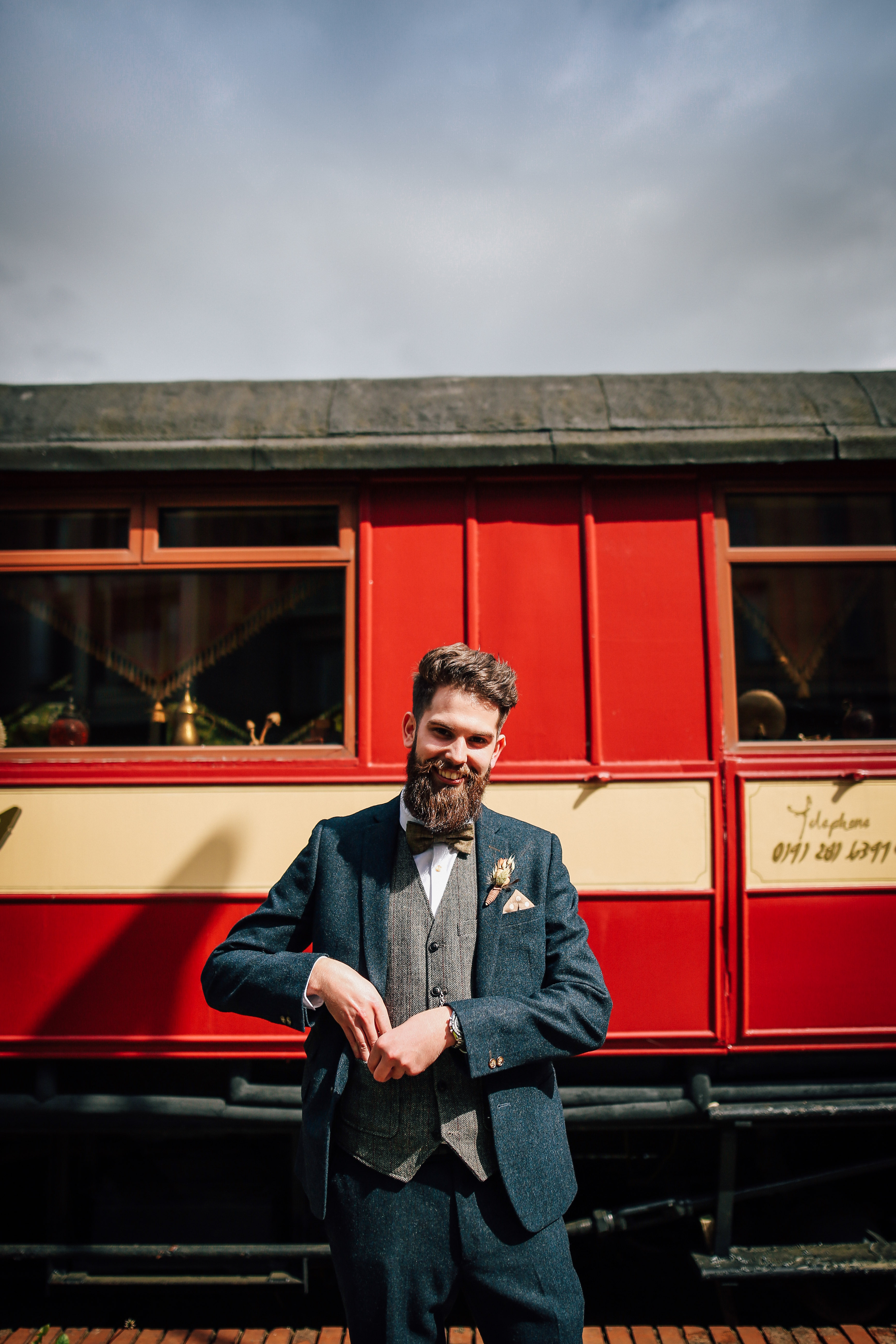 Groom Wedding Portrait in front of train  Newcastle  Wedding Photography As You Like It