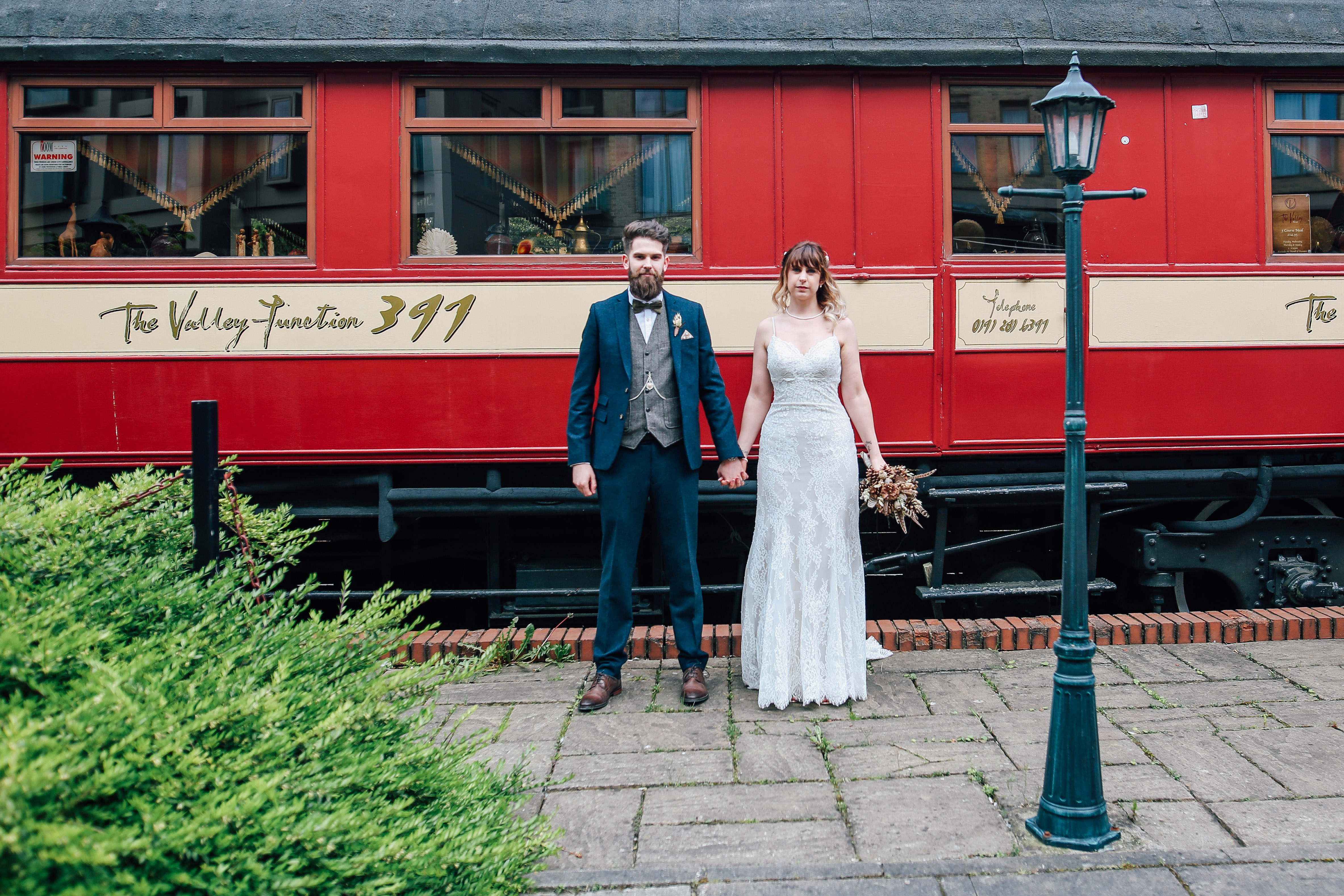 Creative in Front of a Train Newcastle Wedding Photography
