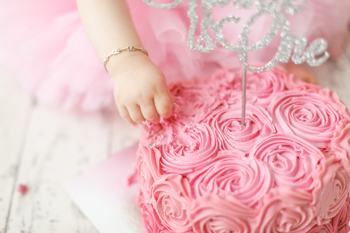 A delicious pink iced cake for our cake smash photoshoot