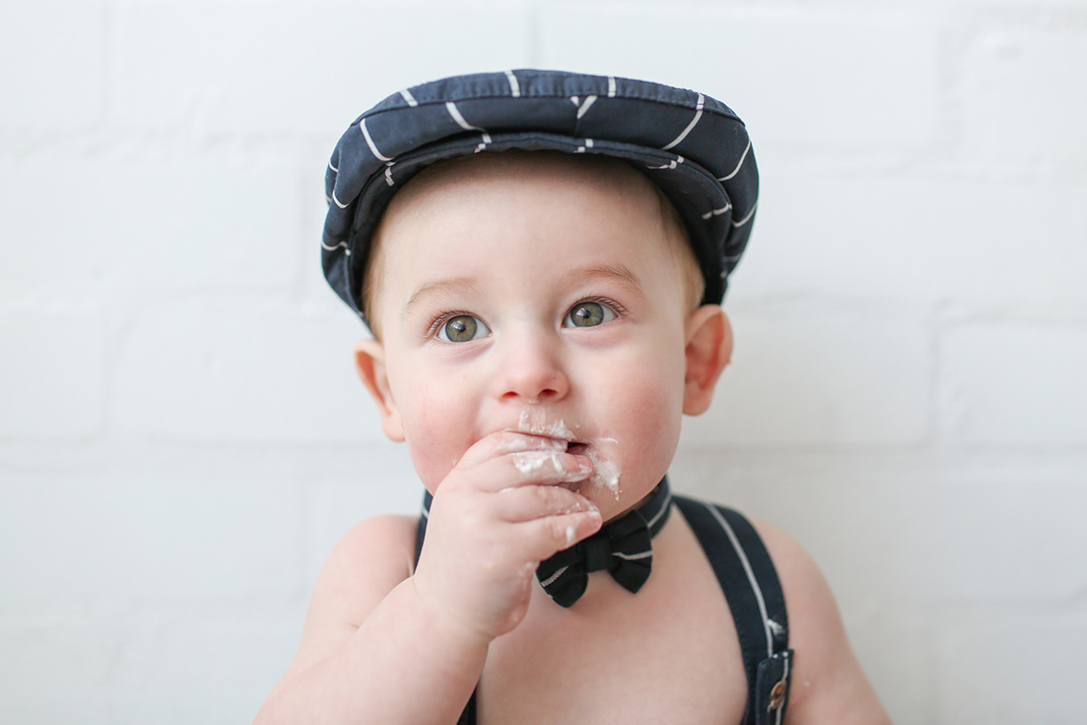 Baby in flat cap Photography Cheshire