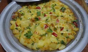 Omelette pommes de terre poivron tomate au tajine