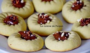 Biscuit au presse agrume à la crème de pistache et son coeur à la confiture de lait cacao et noisettes