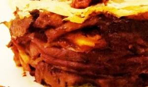 Baklava de canard confit, champignons, fruits secs caramélisés et écrasée de panais-noisettes