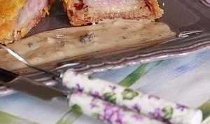 Magrets de canard en croûte de parmesan, sauce aux morilles