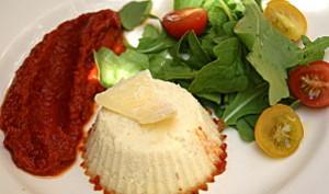 Petits flans au parmesan et son coulis de tomates