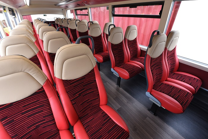Comfy-looking red and cream bus seats