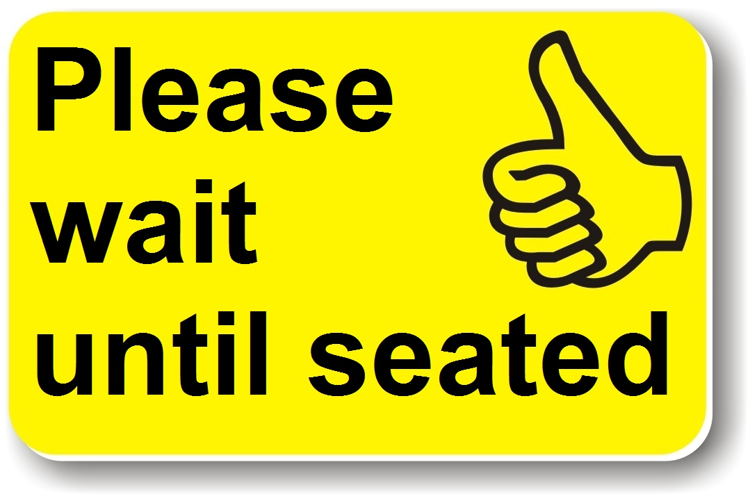 A yellow card saying 'please wait until seated'.