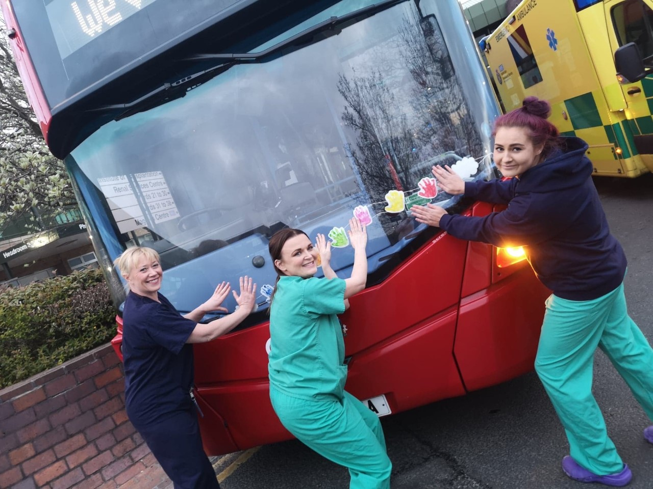 NHS key workers from Freeman Hospital with a Go North East bus