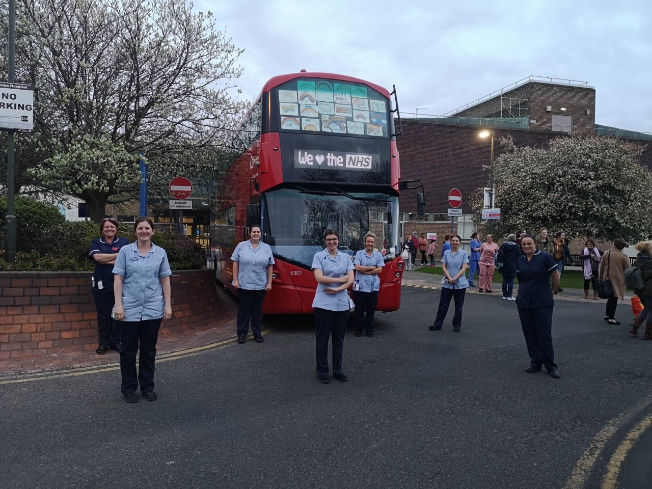 NHS workers and a Go North East bus