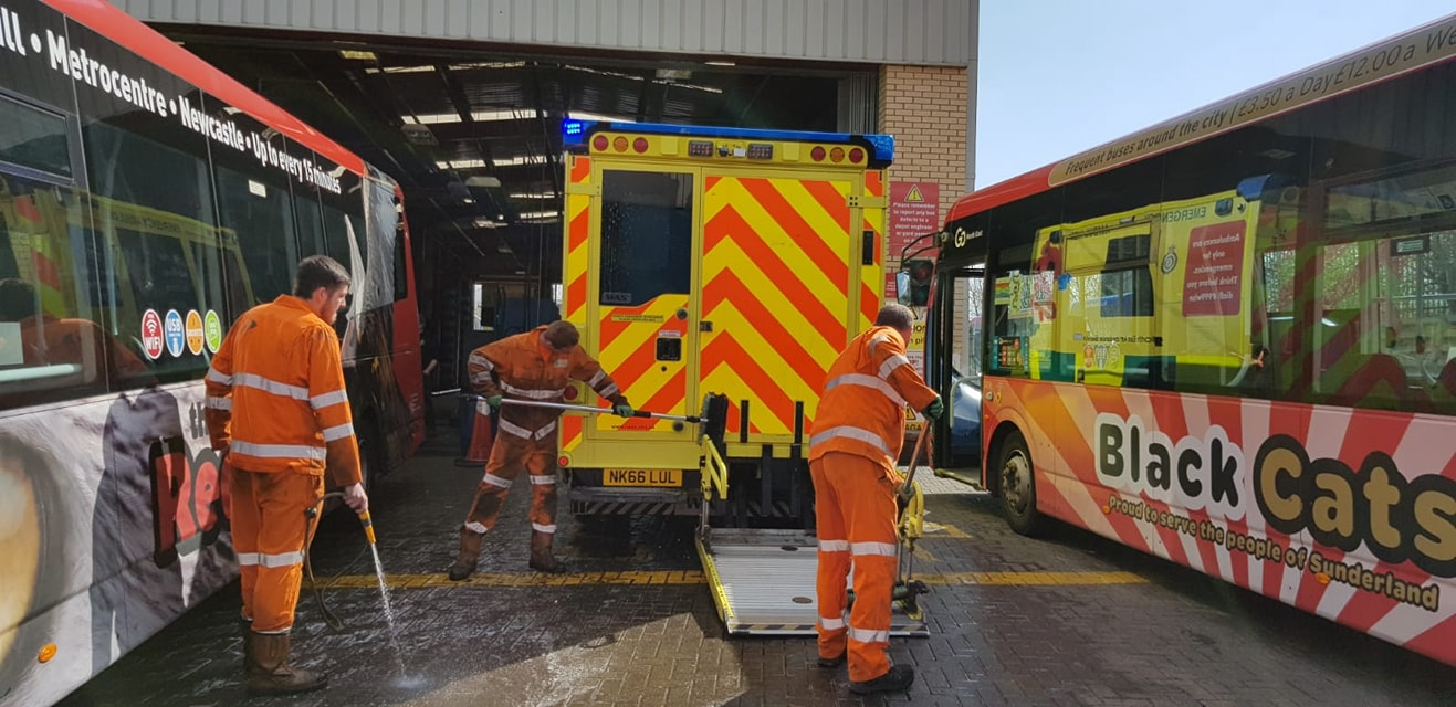 Team members at Go North East's depot in Sunderland helping clean ambulances
