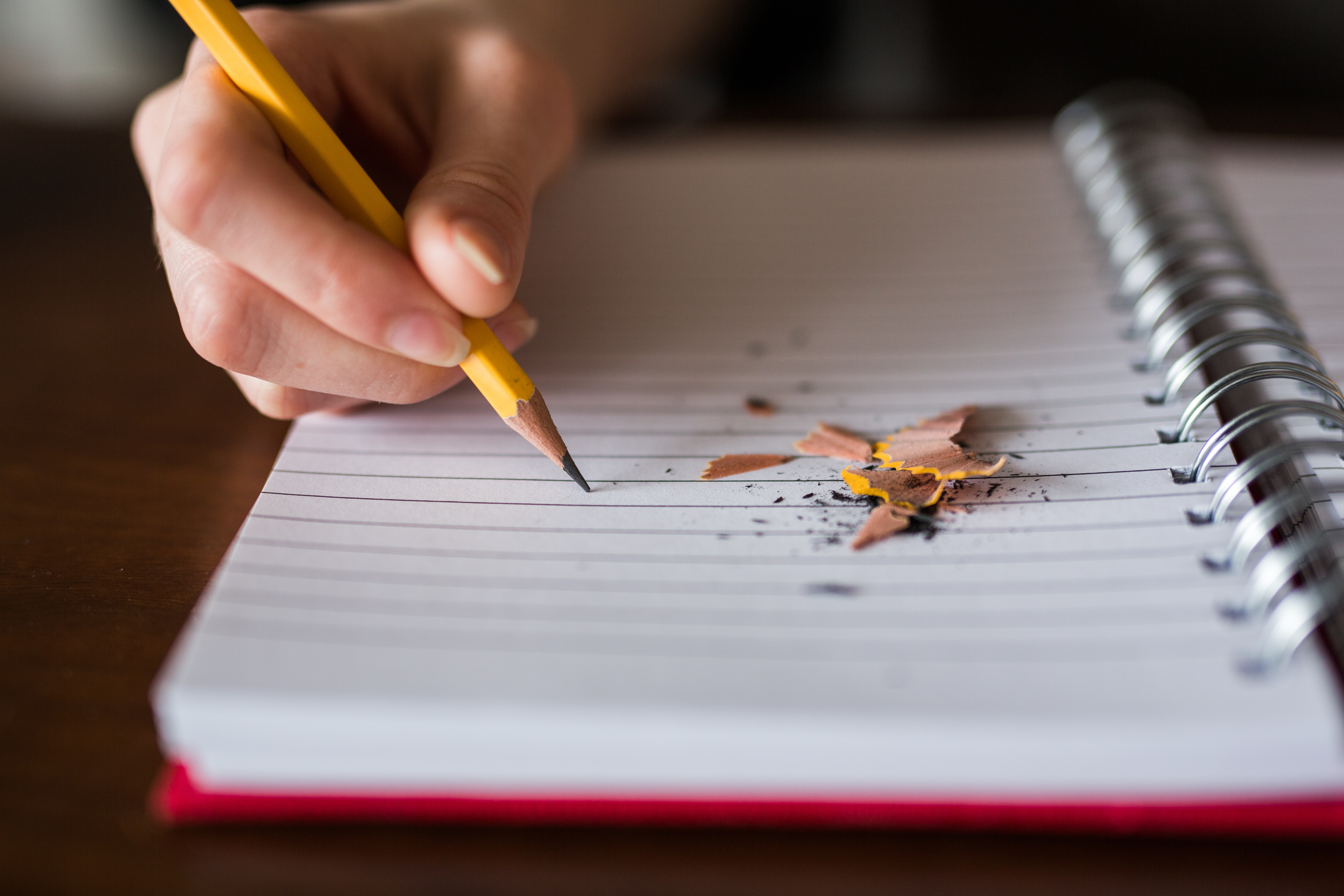 Photo of a child writing in a note pad
