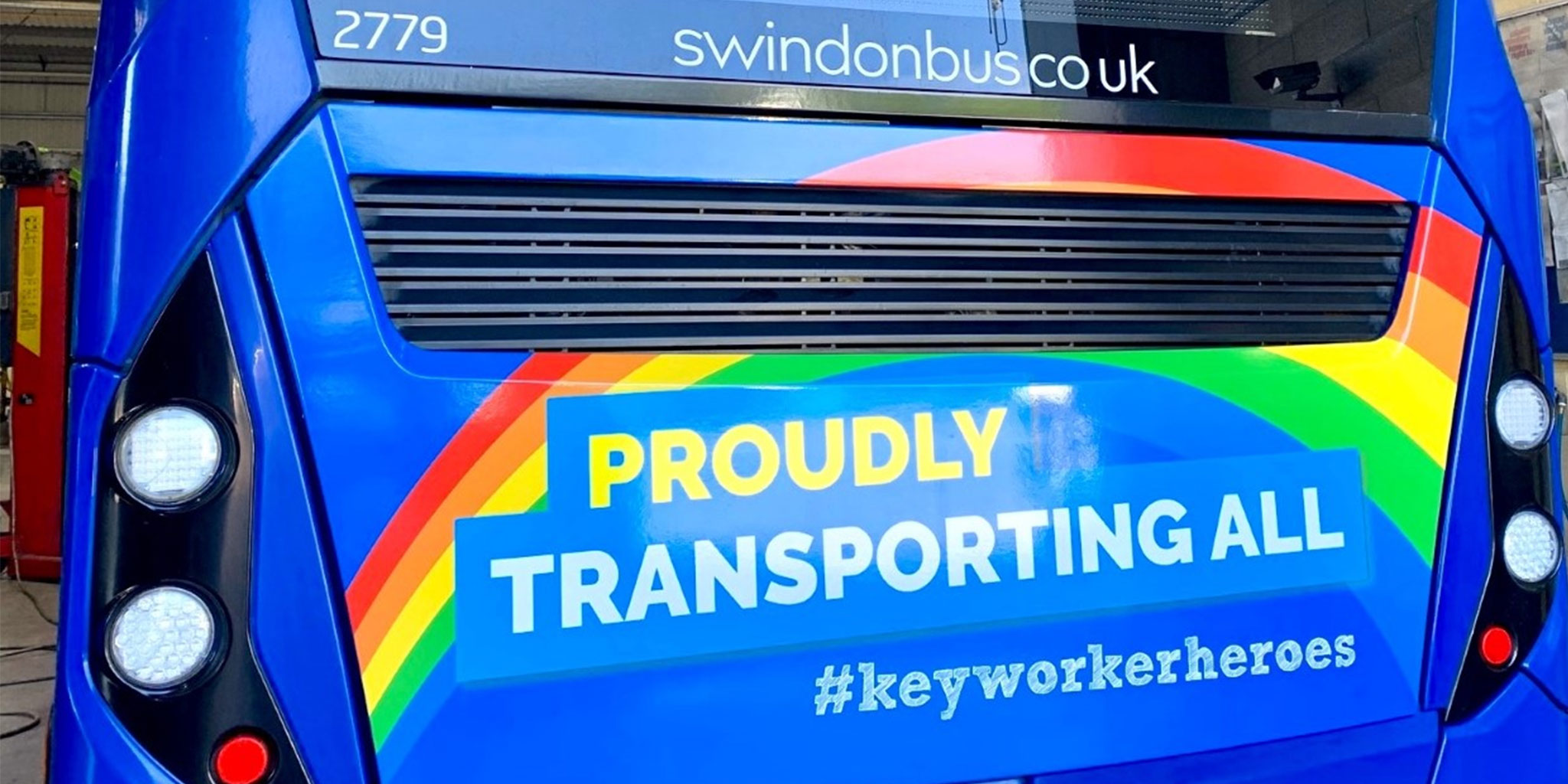 A photo of a Swindon's bus with a rear design reading 'proudly transporting all #keyworkerheroes'