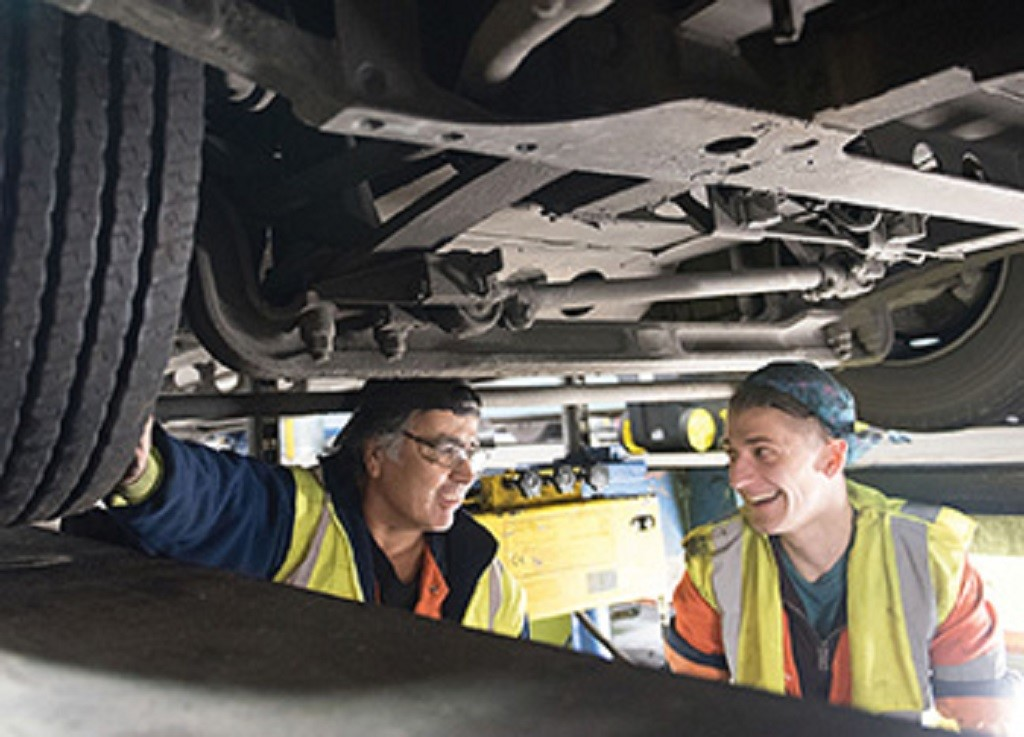 Photo of two engineers working on a vehicle