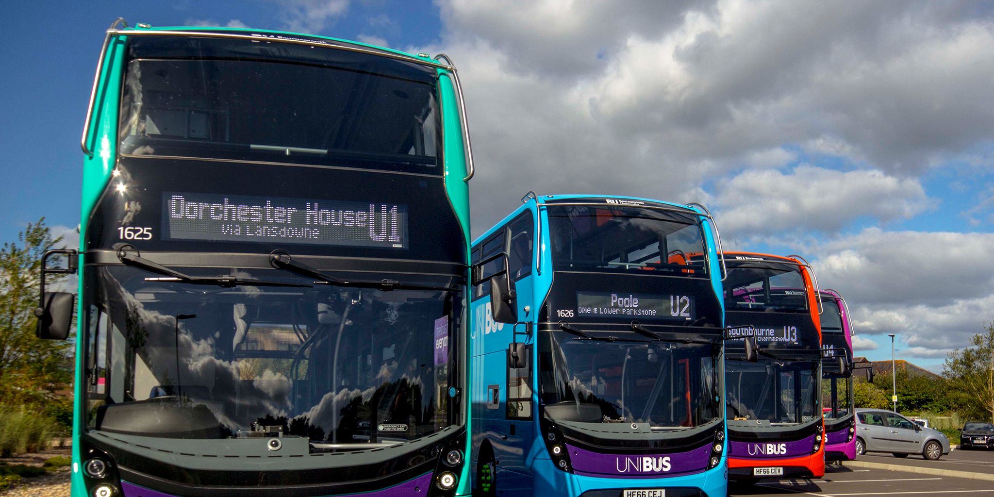Photo of four colourful UNIBUS buses