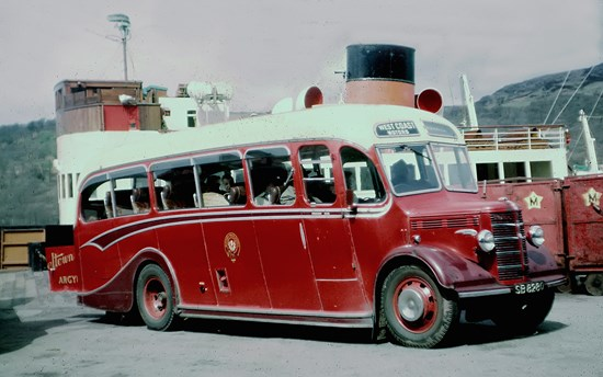 small red 1950s bus