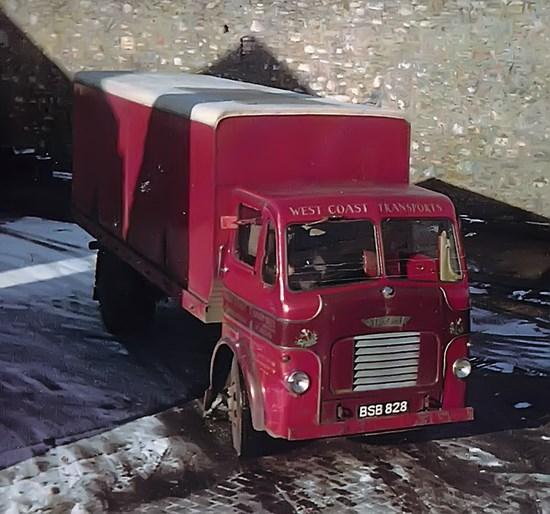 burgundy van in snow
