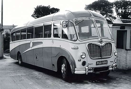 1970s bus small black and white photo