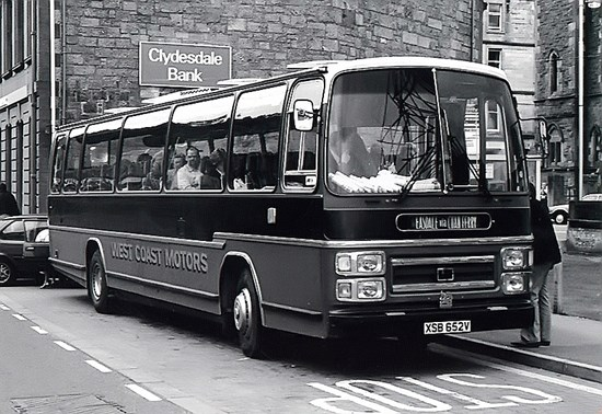 black and white photo of 1980s bus
